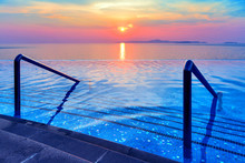 Swimming Pool With Stair And Sunset Background