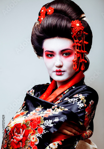 Fotomural young pretty geisha in black kimono among sakura, asian ethno close up on white
