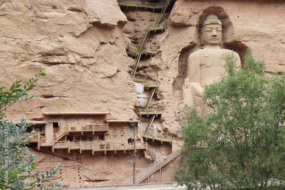 Buddha statue at Bingling Cave Temple in Yongjing, Gansu Province, China.UNESCO World heritage site.(Silk Roads: the Routes Network of Chang'an-Tianshan Corridor)