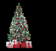 Christmas Tree With Red And White Ornaments Isolated On Black Background