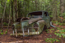 Abandoned Old Car In Forest