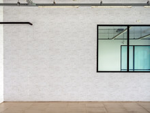 White Brick Wall Background Near The Glass Window In Empty Room.