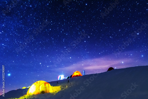 Foto auf Leinwand Dunkelblau Great bright campsite with colorful tourist tents, on top in the Ukrainian Carpathian Mountains, at night with views of the stars and the Milky Way