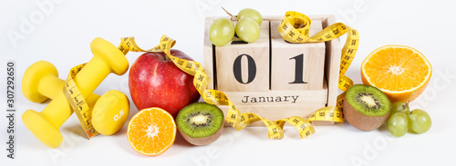 Cube calendar, fruits, dumbbells and tape measure, new years resolutions - 307292650