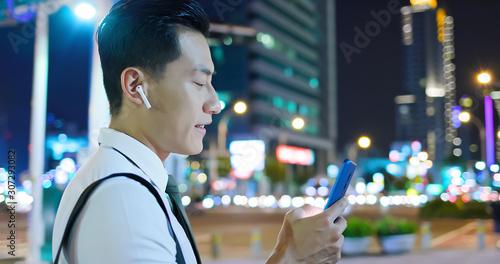 asian man wear wireless earbuds Canvas Print