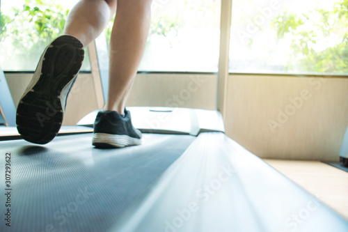 Young people are running on the treadmill in the gym to strengthen muscles and s Tapéta, Fotótapéta