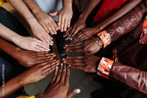 Hands of happy group of multinational African, latin american and european peopl Fototapeta