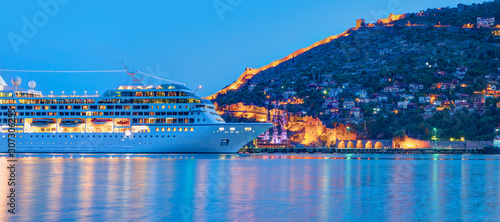 Beautiful white giant luxury cruise ship on stay at Alanya harbor Canvas Print