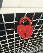Padlock And Heart On Red Background