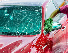 Man Washing A Red Car