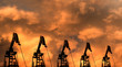 canvas print picture - Silhouettes of oil pumps (pumpjack) at stormy sky