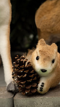Christmas Toy Squirrel Sits With A Bump