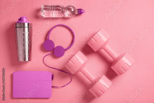 obraz PCV Dumbbells, headphones and protein shaker on the fitness mat