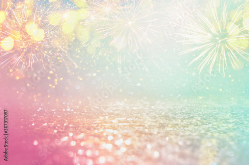 abstract gold, pink and mint glitter background with fireworks. christmas eve, 4th of july holiday concept. pastel colors
