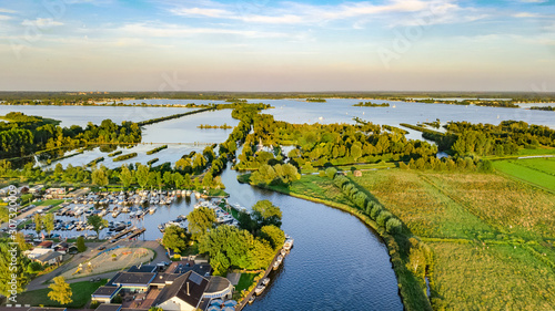Aerial drone view of typical Dutch landscape with canals, polder water, green fi Fototapeta