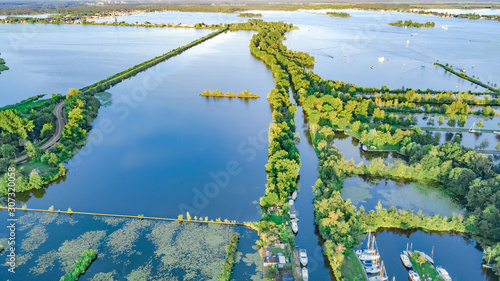 Canvas Print Aerial drone view of typical Dutch landscape with canals, polder water, green fi