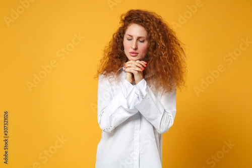 Fényképezés Young redhead woman girl in white shirt posing isolated on yellow orange wall background studio portrait