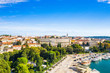 Croatia, Istria, city of Pula, panoramic view of ancient Roman arena, historic amphitheater and old town center from drone