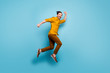 canvas print picture - Full body profile side photo of cheerful crazy man jump run after spring time black friday sales feel rejoice emotions wear casual style clothes isolated over blue color background