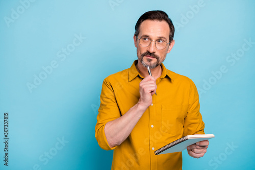 Portrait of serious focused man write essay in his copy book think thoughts cont Canvas