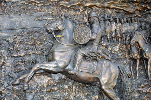 bas-relief depicting a rider with a spear on a horse. Canvas Print