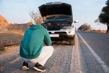 Sad Man With Broken Car