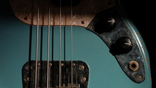 Closeup Of Blue Guitar Bass And Light Coming Through On Body Relic With Selective Focus.