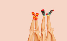 Funny Striped Socks. Legs Of A...