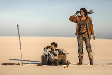 Post Apocalyptic Woman And Boy Outdoors In A Wasteland