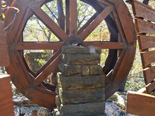 Close Up Of A Wooden Waterwheel At A Park
