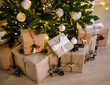 Leinwanddruck Bild close up of beige gift boxes under decorated christmas tree