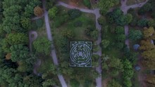 Birds Eye View From Drone To A Labyrinth In The Botanical Garden At Summer Evening.