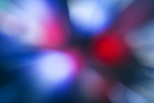 Blurred Lights Dark Blue, Red, Pink Background. Abstract Soft Explosion Effect. Centric Motion Pattern