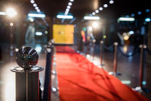 Red Carpet With Barriers And Velvet Ropes.