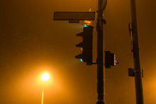 Traffic Light At Night, Traffic Light And Foggy Night, A Blank Sign For Street Names At Night