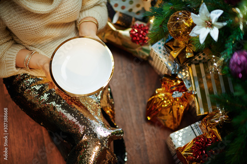 Closeup on 40 year old woman holding empty plate