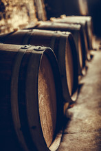 Wooden Barrels In A Dark Cellar