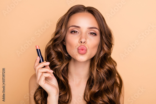 Canvastavla Close up photo of charming girl hold lipstick pomade prepare for date send air k