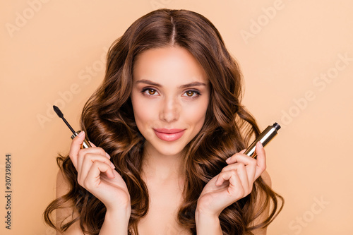 Obraz Close up photo of charming attractive lady hold mascara want prepare for date isolated over beige color background - fototapety do salonu