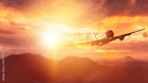 Foto auf AluDibond Koralle Airplane flying over mountain on dramatic sunset sky abstract background.