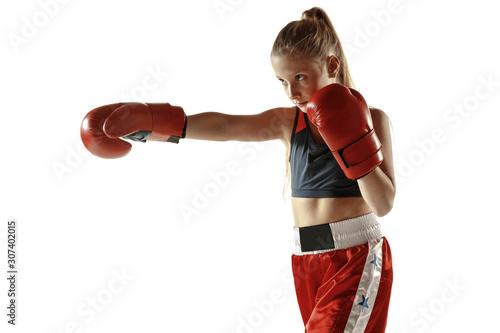 Valokuvatapetti Young female kickboxing fighter training isolated on white background