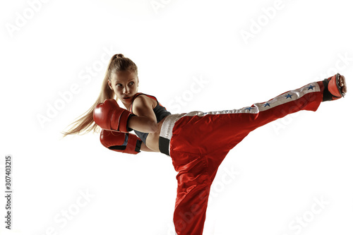 Canvas Print Young female kickboxing fighter training isolated on white background