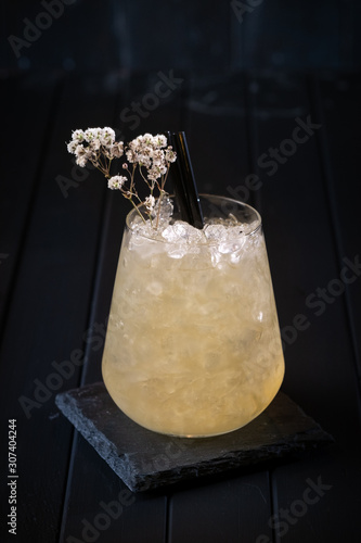 Valokuva Cocktail is an old fashioned classic julep glass on a dark wooden background