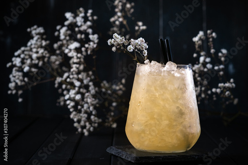 Valokuvatapetti Cocktail is an old fashioned classic julep glass on a dark wooden background