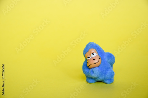 blue toy yeti, place for space, blue toy monkey, gorilla Wallpaper Mural