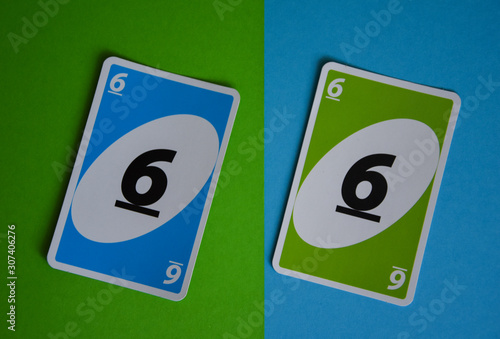 Photo  Deck of Uno game cards scattered all over on a table