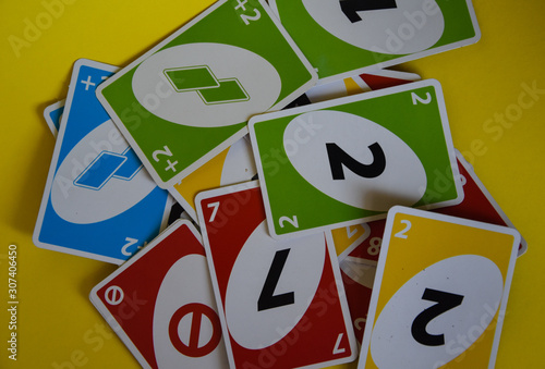 Deck of Uno game cards scattered all over on a table Canvas Print