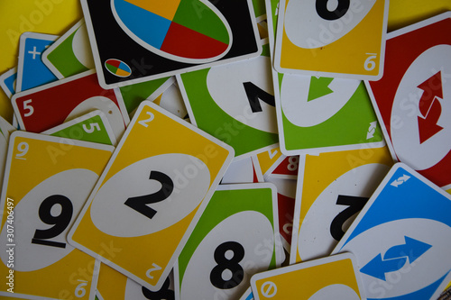 Deck of Uno game cards scattered all over on a table Wallpaper Mural