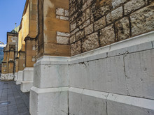 Side Of An Old Building Architecture Facade With A View Of Old Stones Making Up Bricks For Entire Wall, Historical Cathedral Monument In Sarajevo