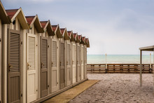 Wooden Beach Cabins On The Seaside In Tuscany